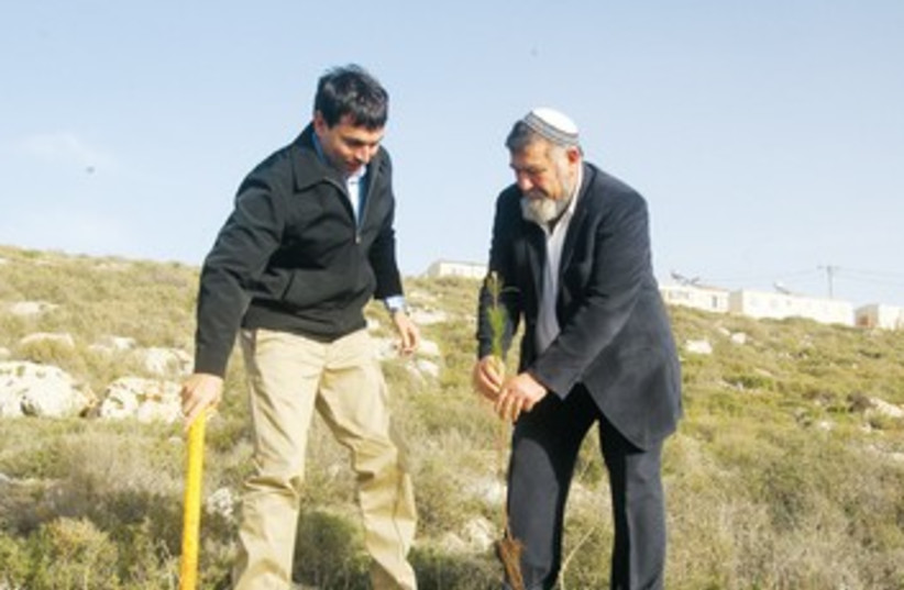 Danny Danon and Gershon Mesika plant a tree 390 (photo credit: Samaria, It's Nice to Know You initiative)