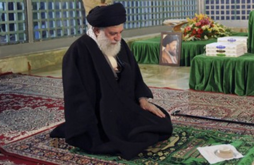 Ayatollah Ali Khamenei prays 390 (photo credit: REUTERS)