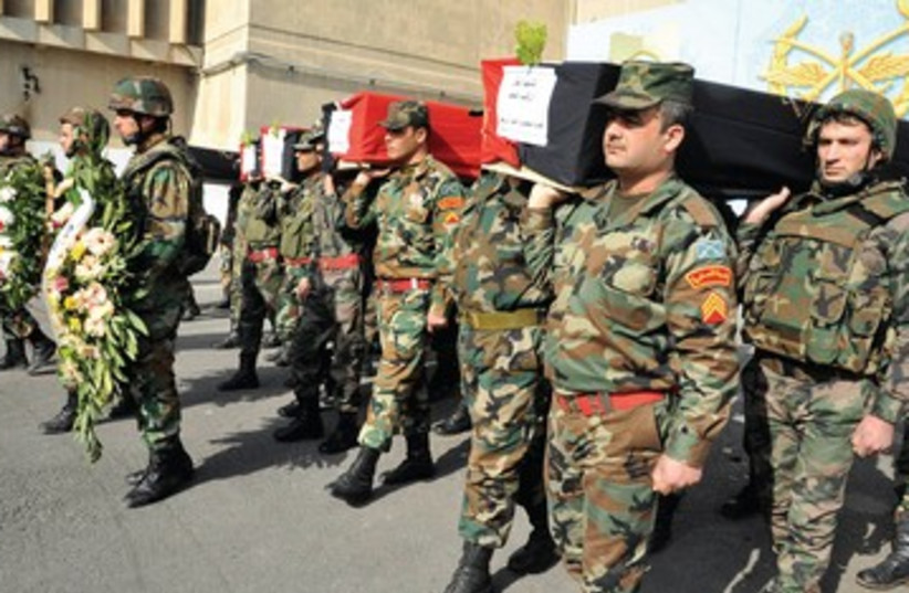 Syrian soldiers funeral 390 (photo credit: REUTERS)
