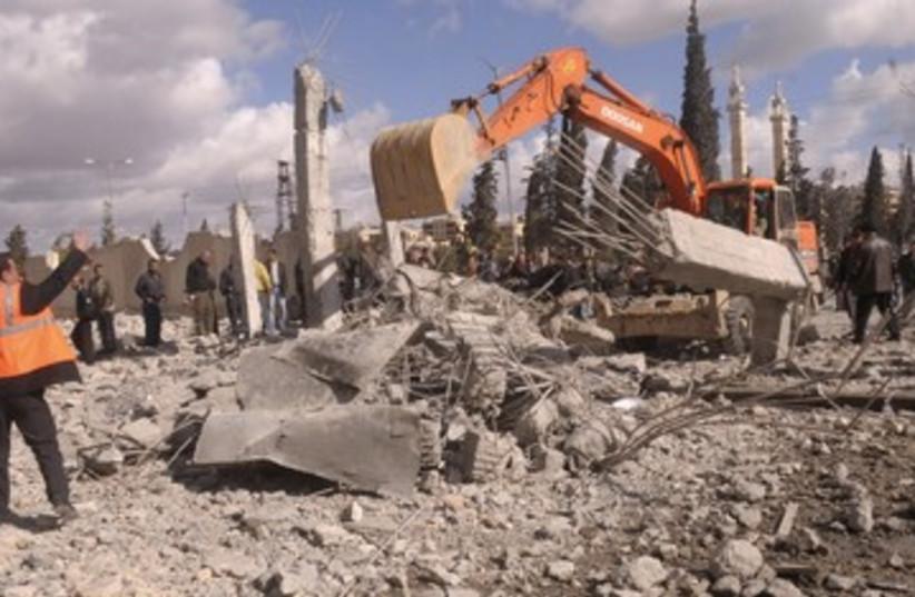 Excavator at site of Aleppo blasts 390 (photo credit: REUTERS/Stringer)
