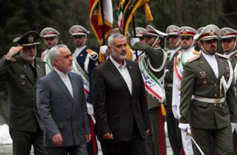Hamas PM Ismail Haniyeh arrives in Tehran Iran 390 (R) (photo credit: REUTERS/Morteza Nikoubazl)