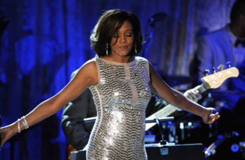 Whitney Houston performs at the Pre-Grammy Gala 390 (photo credit: REUTERS/Phil McCarten)