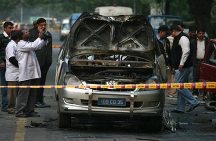 Exploded car at Israeli New Delhi embassy in India 390R (photo credit: REUTERS/Parivartan Sharma)