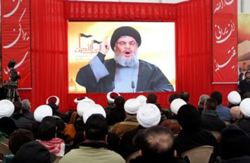 Hezbollah leader Hassan Nasrallah 390 (R) (photo credit: REUTERS/ Ahmad Shalha)