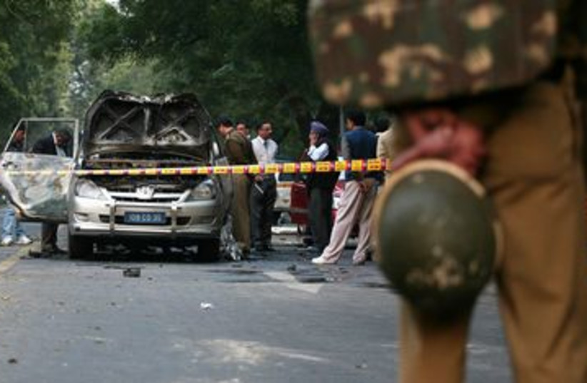 Indian police inspect bombed car in New Delhi 390 (R) (photo credit: REUTERS/Parivartan Sharma)