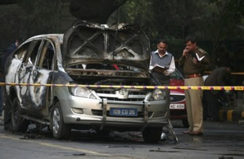 India police inspect car after embassy attack_390 (photo credit: Reuters)