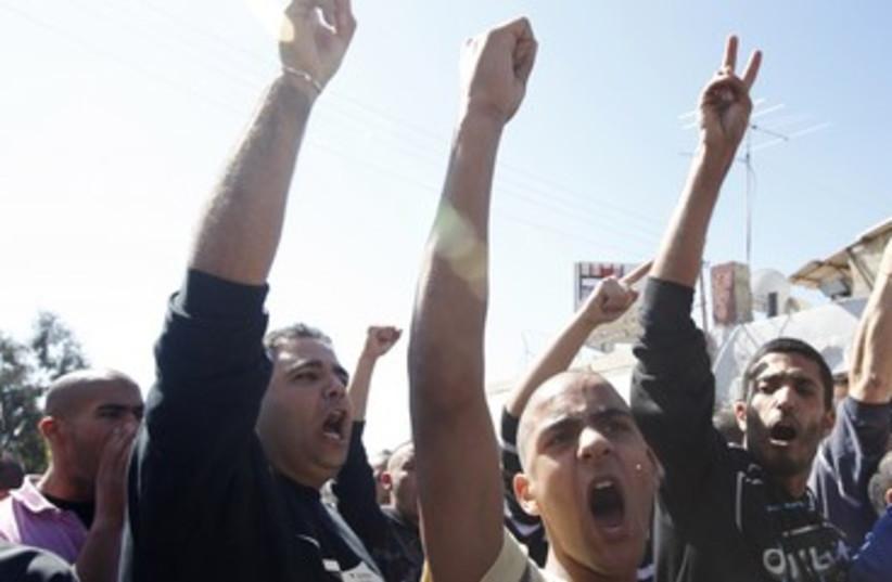 Israeli Arabs at protest in Jaffa R 390 (photo credit:  REUTERS/NIR ELIAS)
