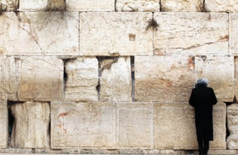Man prays at Western Wall 390 (photo credit: Marc Israel Sellem)