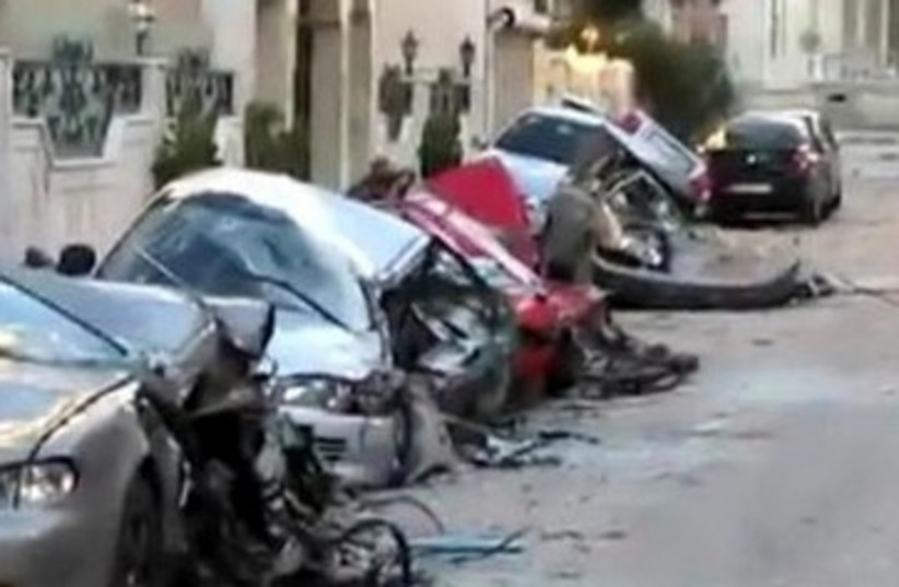 Cars damaged in Homs 390 (photo credit: Reuters)