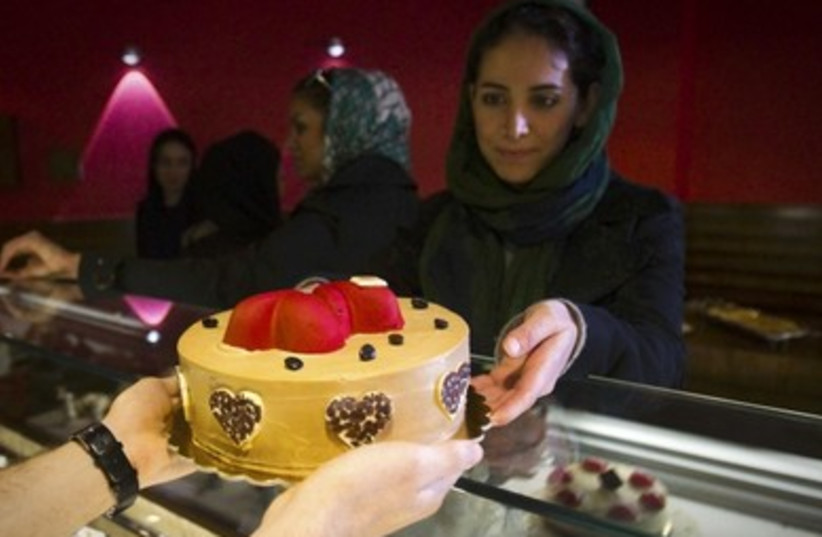 An Iranian woman buys a Valentine's Day cake at a