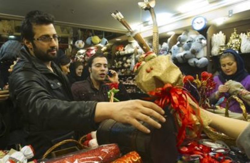 An Iranian man buys a gift during Valentine's day