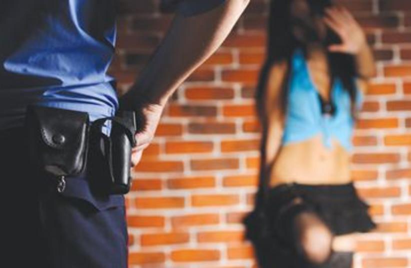 Prostitute and police 390 (photo credit: Thinkstock/Imagebank)