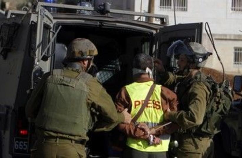 IDF soldiers detain a journalist in Nabi Saleh 390 (R) (photo credit: Mohamad Torokman / Reuters)