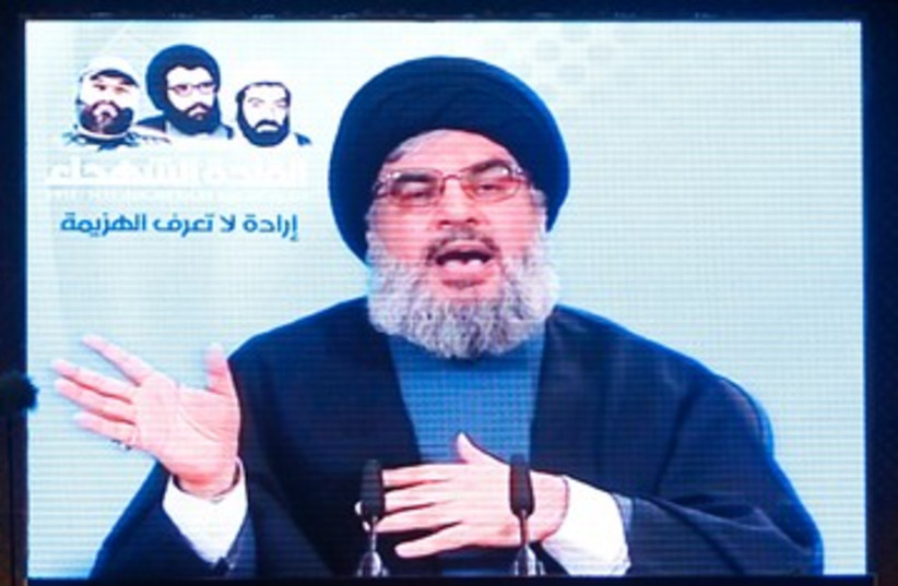 Hezbollah leader Nasrallah speaks to supporters 390 R (photo credit: REUTERS)
