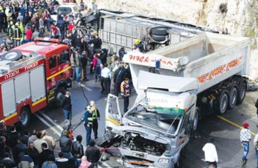 bus accident jerusalem crash 390 R (photo credit: Ammar Awad/Reuters)