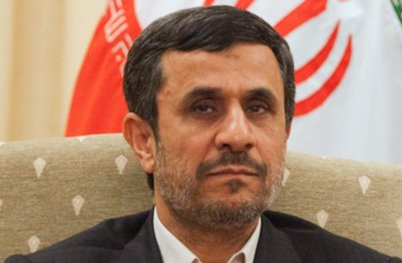 Ahmadinejad attends a meeting with Pakistan's PM 390 R (photo credit: REUTERS)