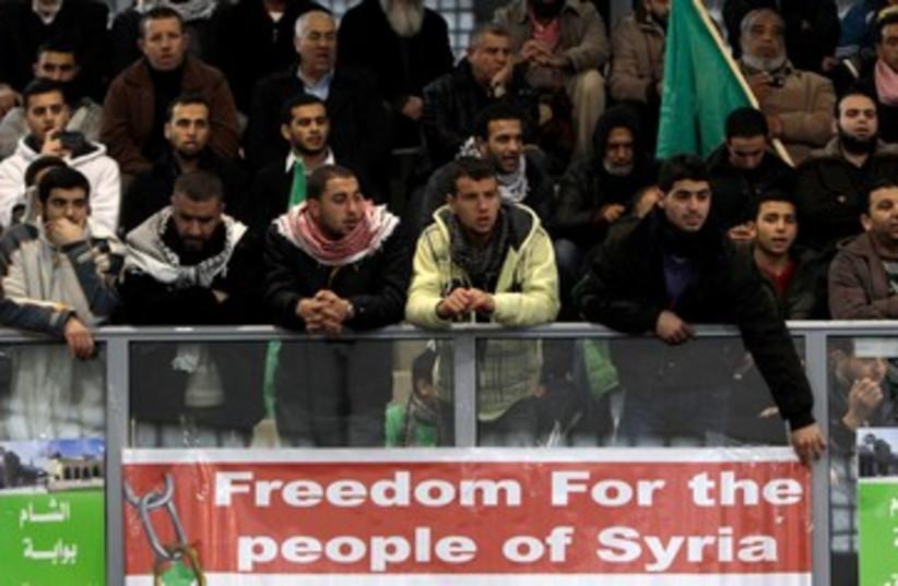 Arab Israelis protest Syrian Assad 390 (photo credit: REUTERS/Ammar Awad)