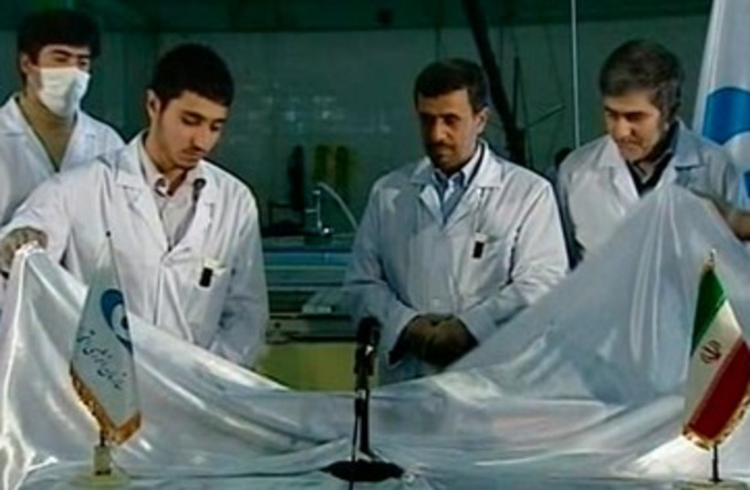 Ahmadinejad nuclear unveiling 390 (photo credit: REUTERS)