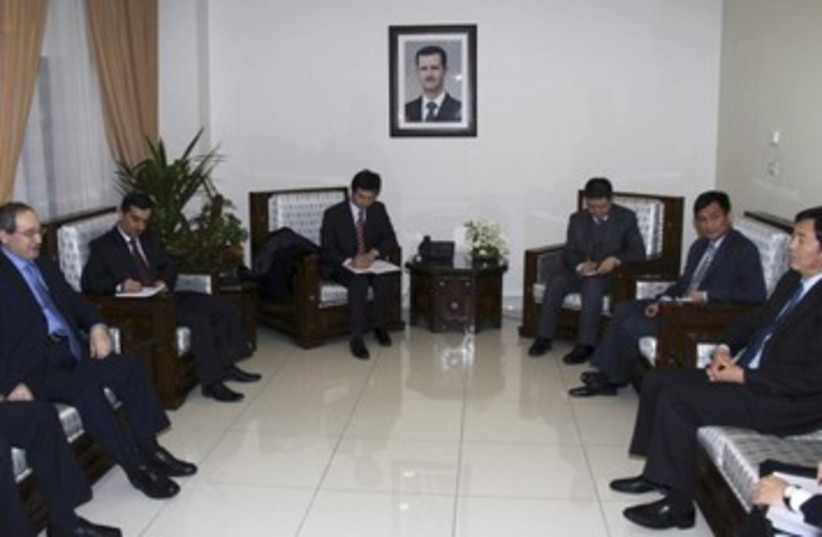 Chinese diplomats in Damascus_390 (photo credit: Reuters)