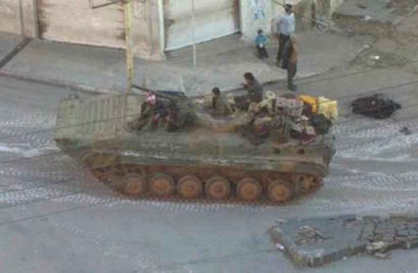 Syrian tank in a Damascus suburb 390 (R) (photo credit: REUTERS/Handout)