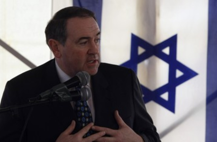 Mike Huckabee in Jerusalem 390 (R) (photo credit: Baz Ratner / Reuters)