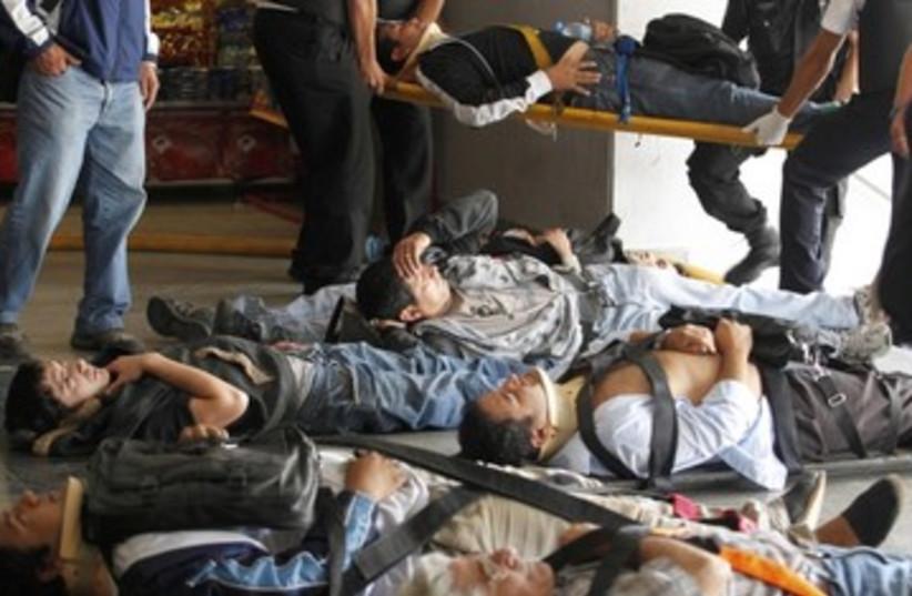 Vicitms in Argentine train crash_390 (photo credit: Enrique Marcarian/Reuters)