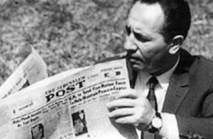 peres with post 1964 (photo credit: Jerusalem Post archives)