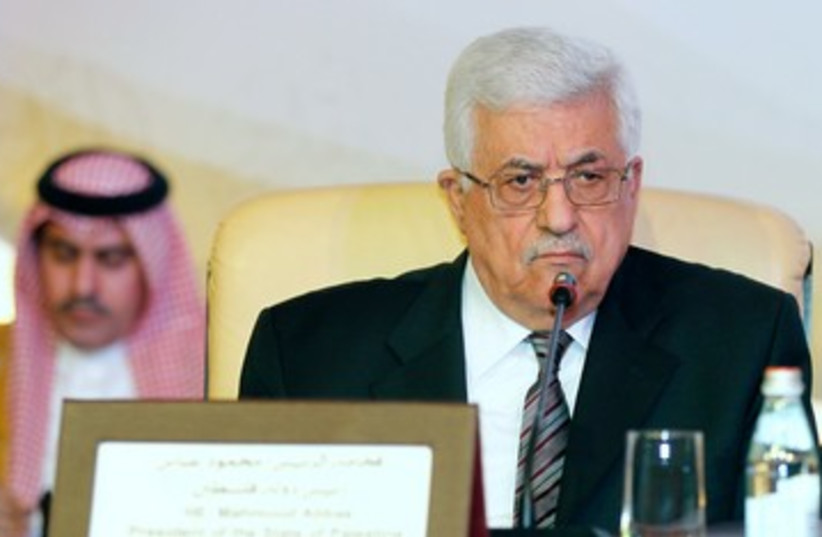 PA President Abbas at Doha conference on J'lem 390 (R) (photo credit: REUTERS/Mohammed Dabbous)