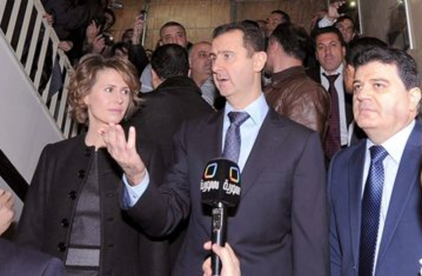 Syrian President Bashar Assad at polling station 390 (R) (photo credit: REUTERS/SANA)