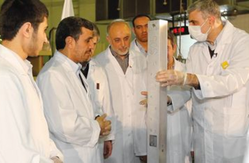 Ahmadinejad at nuclear ceremony in Tehran 390 (R) (photo credit: REUTERS)