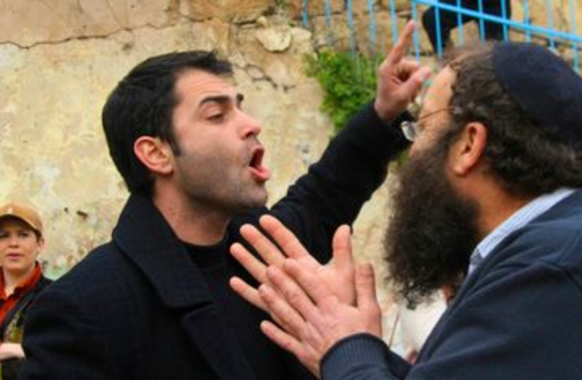 Meretz activist Gitzin argues with Baruch Marzel_390 (photo credit: Tovah Lazaroff)