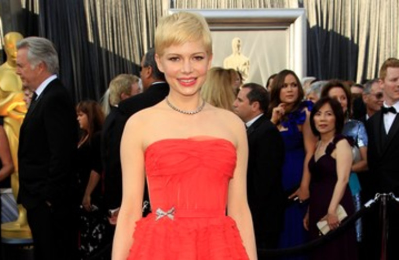 Michelle Williams arrives at the Oscars 390 (photo credit: REUTERS)