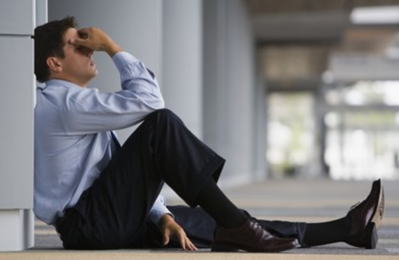 Overwhelmed anxious businessman 390 (photo credit: Thinkstock/Imagebank)
