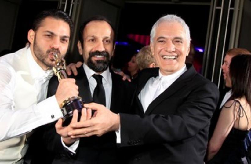 'A Separation' director Asghar Farhadi (C) 390 (R) (photo credit: REUTERS/Lucy Nicholson)