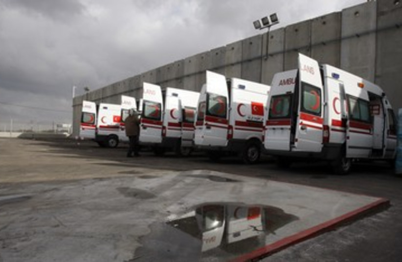 Palestinian Red Crescent ambulances [file] 390 (R) (photo credit: Baz Ratner / Reuters)
