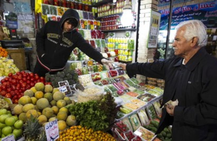 Iranian man shops in a bazar in Tehran  R 390 (photo credit: REUTERS)