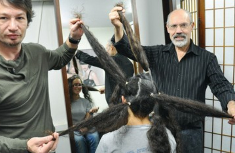 LIRON POLLACK donates hair haircut 390 (photo credit: Courtesy Kaplan Medical Center)