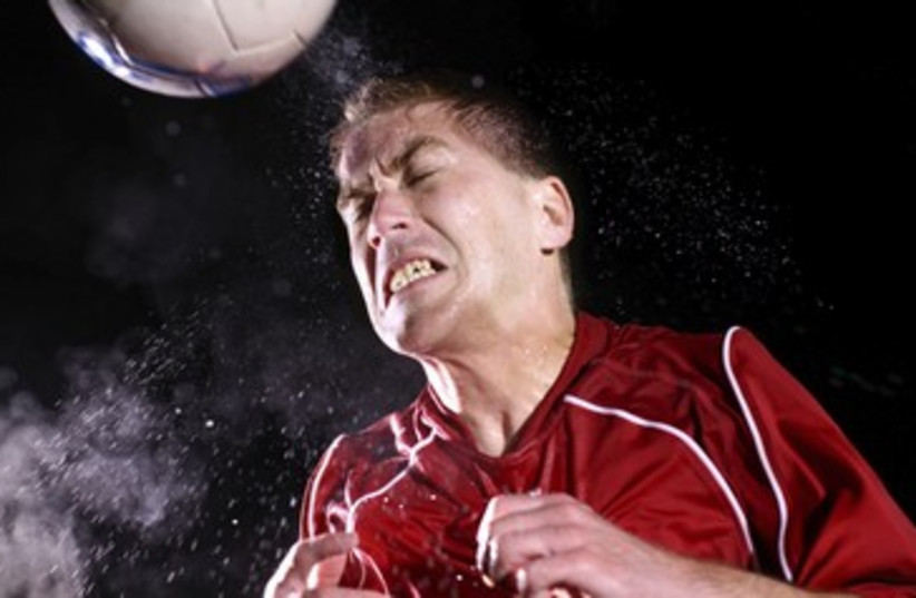 Soccer player hitting ball with head 390 (photo credit: Thinkstock/Imagebank)