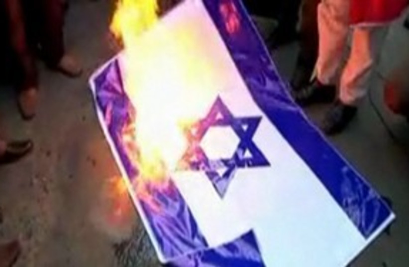 Burning Israeli flag 390 (photo credit: REUTERS)
