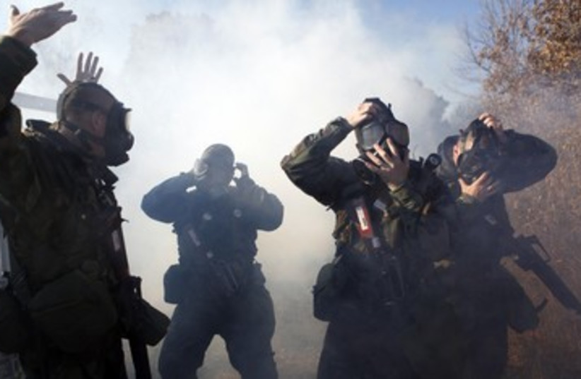 Chemical weapons drill 390 (photo credit: Reuters)