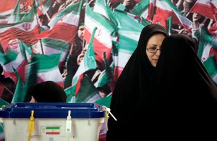 Iran election officials polls ballots 390 (photo credit: REUTERS/Morteza Nikoubazl )