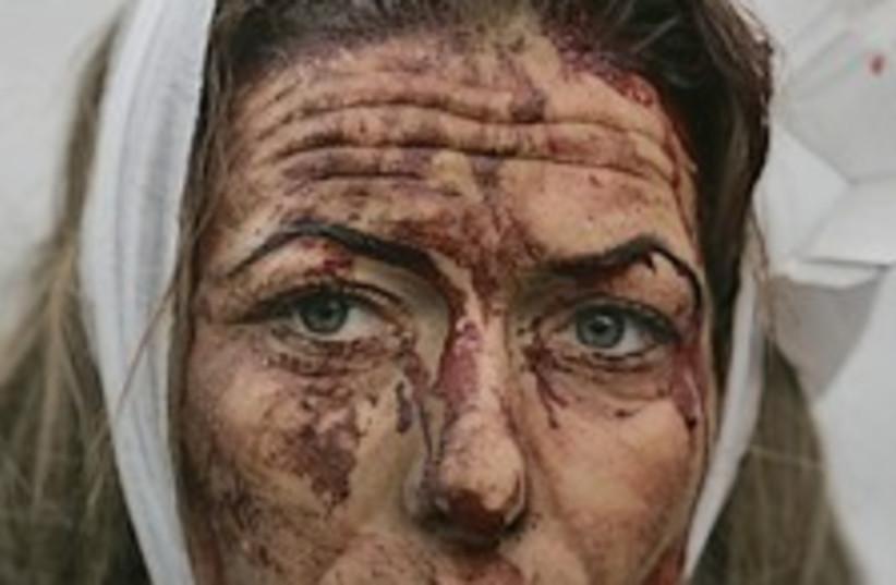 woman hurt kassam sderot (photo credit: AP)
