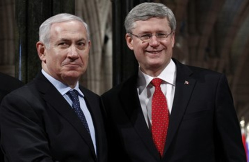 Netanyahu shakes hands with Candian counterpart R 390 (photo credit: REUTERS)