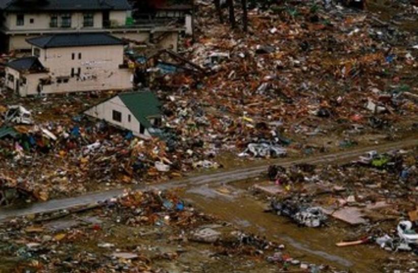 Tsunami damage 390 *DO NOT REPUBLISH* (photo credit: CECAR – Climate and Ecosystems Change Adaptation R)