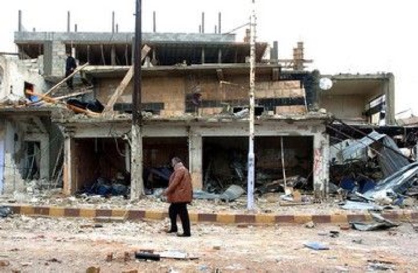 The site of a blast in Syria's Deraa 390 (R) (photo credit: REUTERS/SANA/Handout)