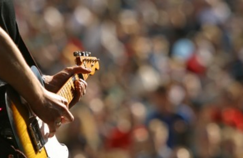 Guitar concert music performance audience rockin 390 (photo credit: Thinkstock/Imagebank)