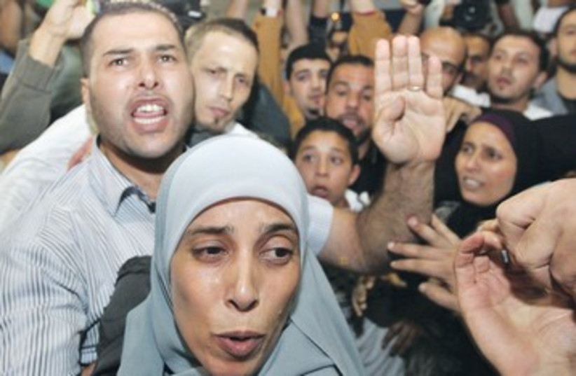 AHLAM TAMIMI greeted by relatives in Jordan 390 R (photo credit: Muhammed Hamed/Reuters)