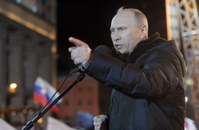 Vladimir Putin addresses supporters 390 (R) (photo credit: REUTERS/Aleksey Nikolskyi/RIA Novosti/Pool)