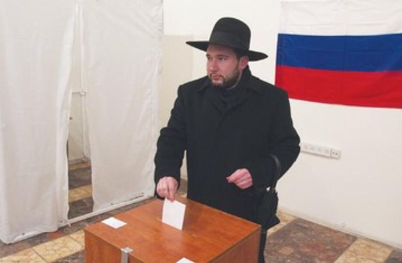 NATAN SHUSTIN, a Moscow native, casts his ballot 390 (photo credit:  NATAN SHUSTIN, a Moscow native, casts his ballot)