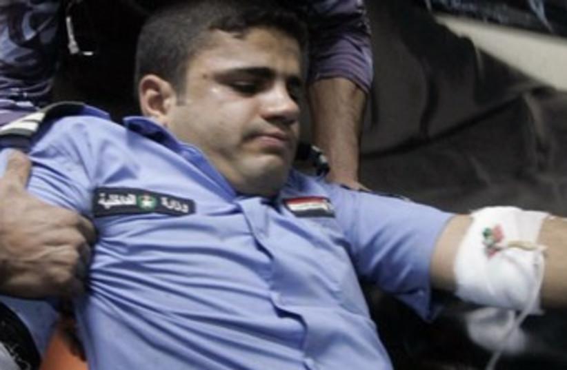 Injured Iraqi policeman 370 R (photo credit: Reuters/Ako Rasheed)